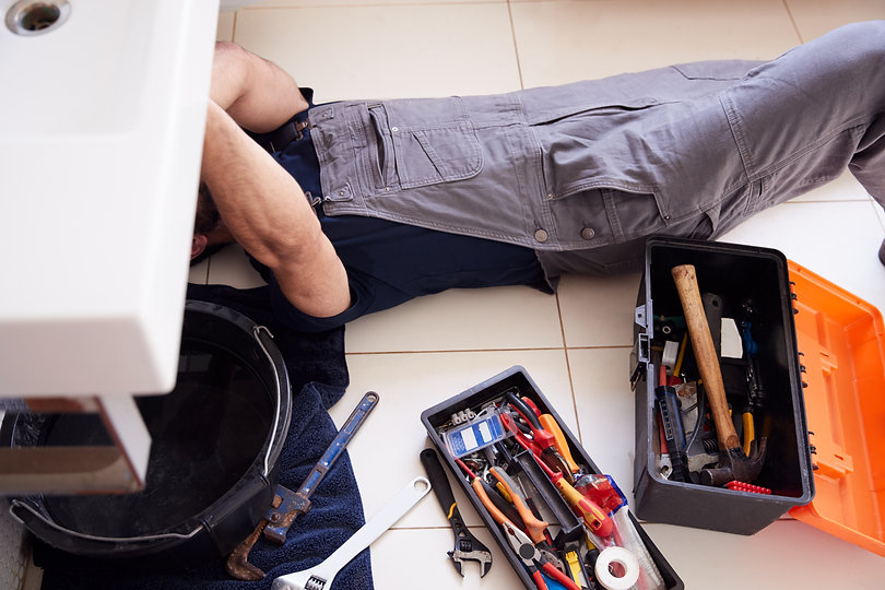 overhead-shot-of-male-plumber-working-to