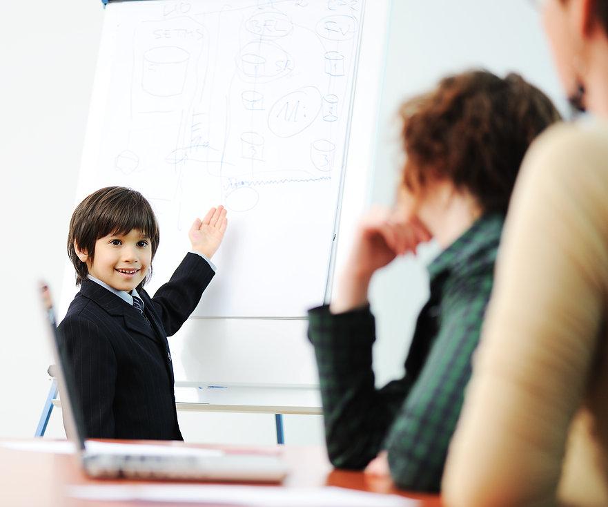 Genius kid on business presentation spea