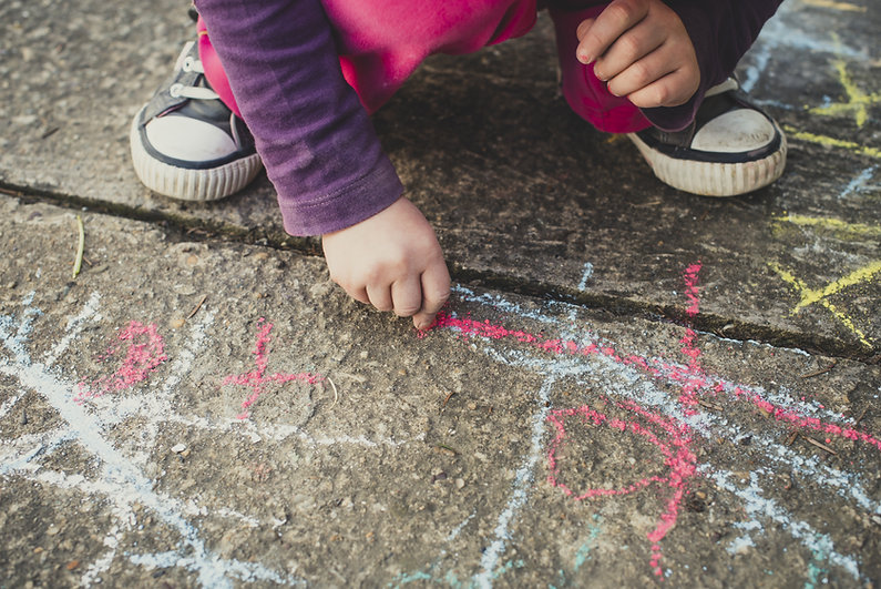Children playing with colored chalks.jpg