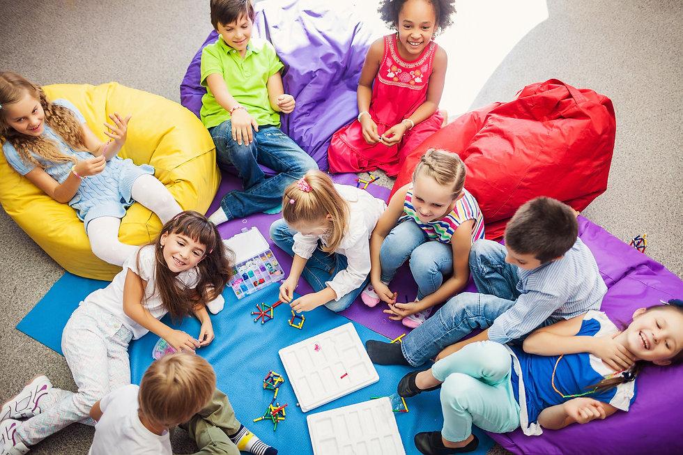 Large Group of happy smiling kids sittin