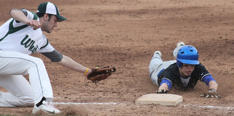 Lake Central baseballer slides to beat the tag against a Whiting Oiler.