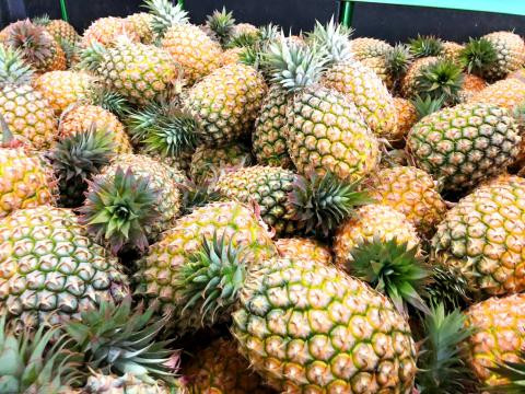 Are pineapples bad for you? pile of pineapples