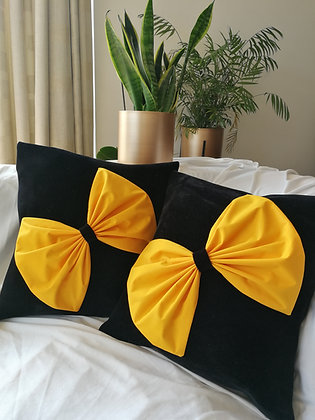 Velvet cushion cover with yellow bow
