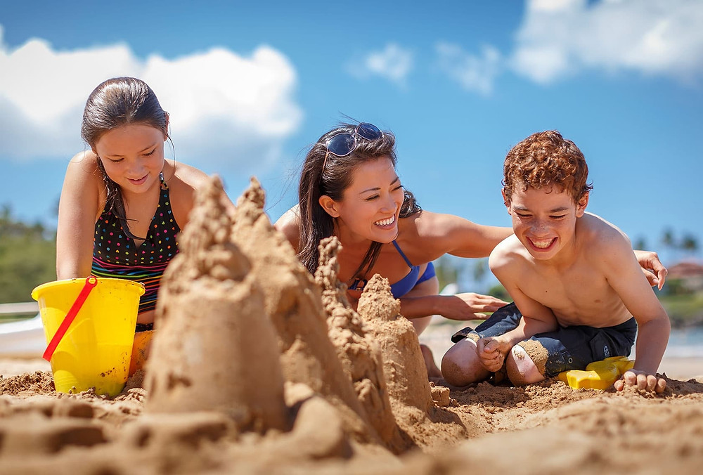 Handyman Projects - Family Building Castle in the Sand