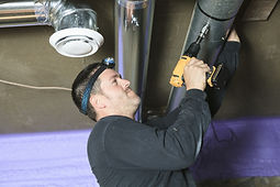 Duct Repair - Worker Repairing Duct