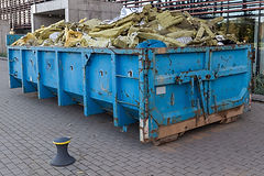 Waste container with construction waste,