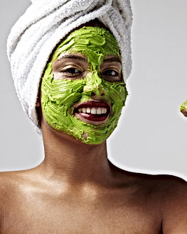 woman wearing a towel and avocado facial