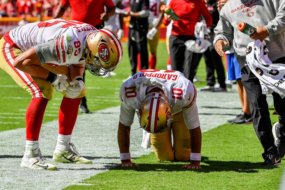 Jimmy Garoppolo hunched over