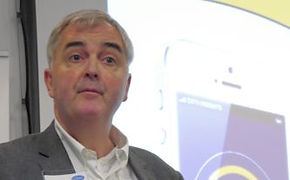Iain Miskimmin presents Phil Jackson with COMIT Fellowship