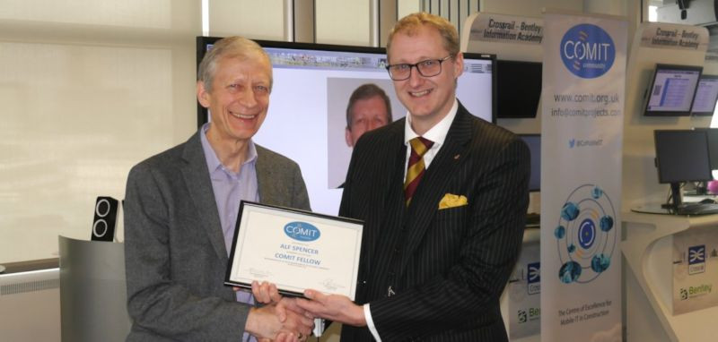 Iain Miskimmin presents Alf Spencer with his Certificate of Felllowship
