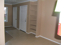 1 Bed Room Entry and Book Case