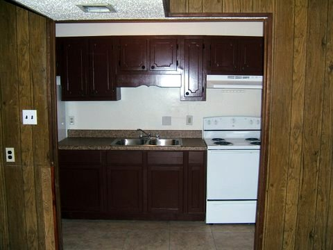Kitchen Of Studio W/ Walk -In Closet