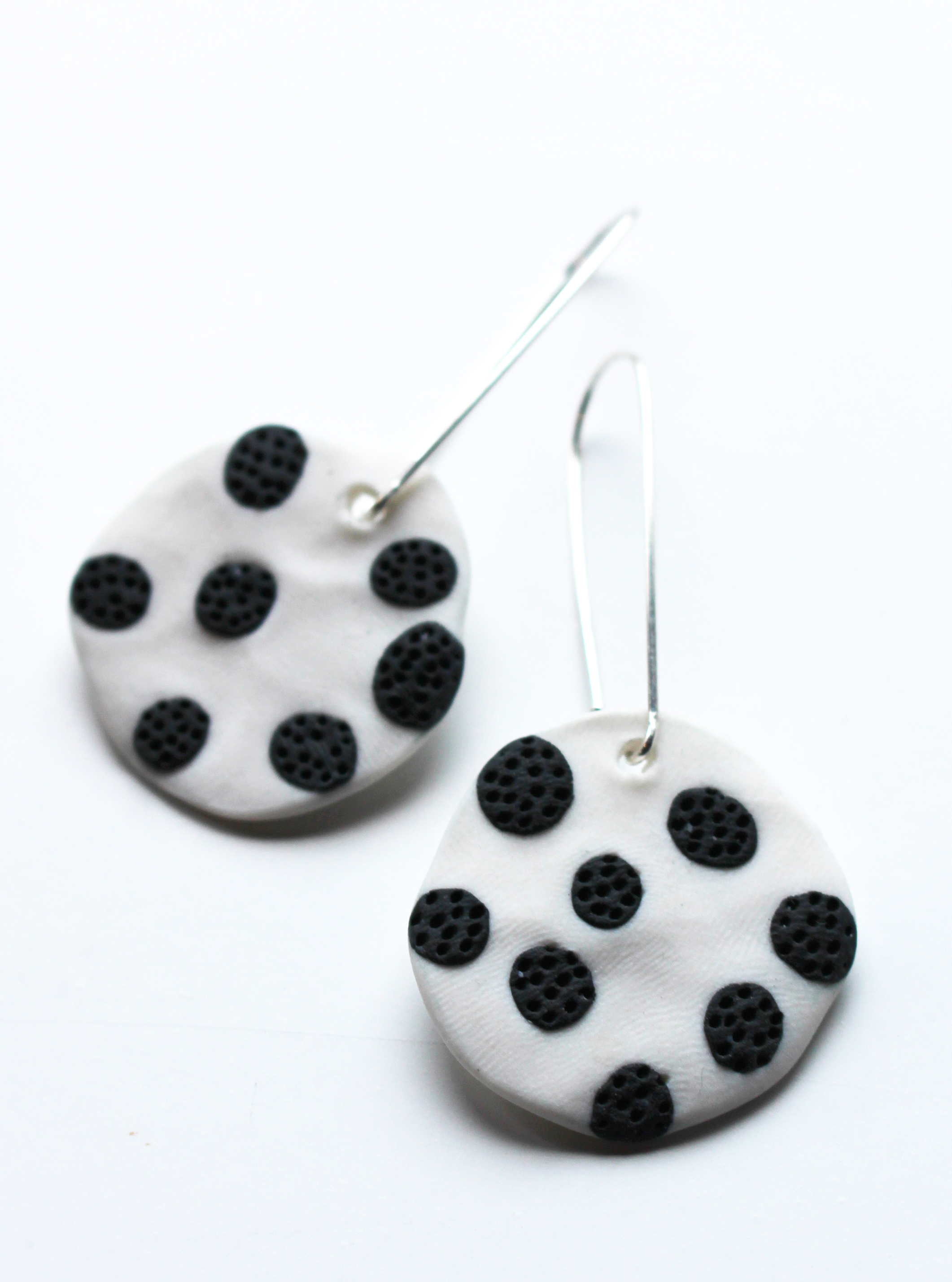 Black spotted pinned coral earrings
