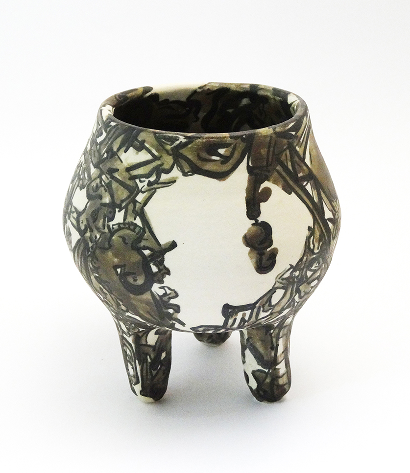 Hand formed footed vessel