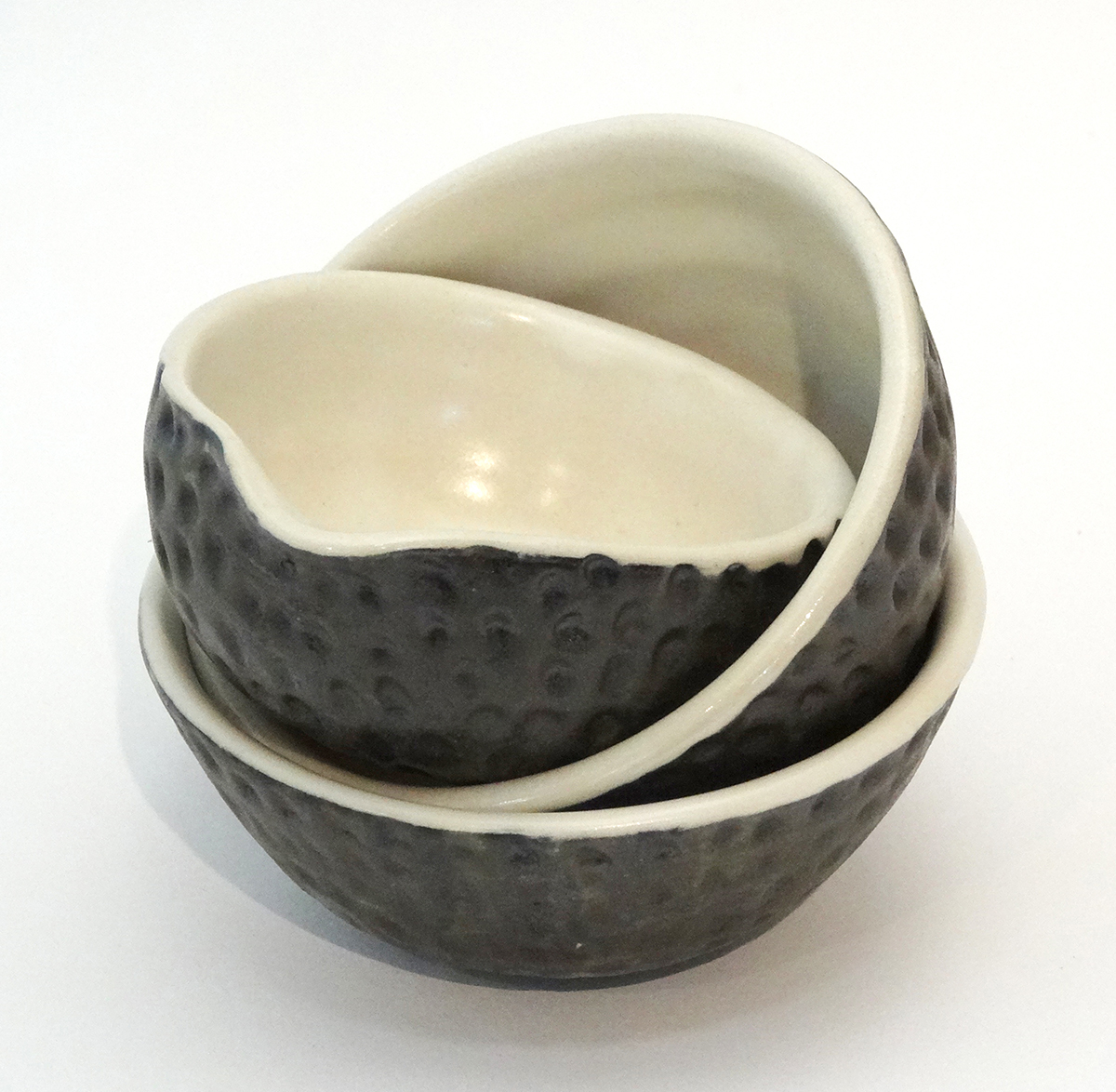 Three small condiment bowls