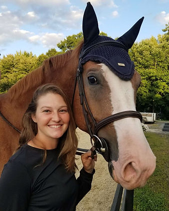 trainer posing with horse
