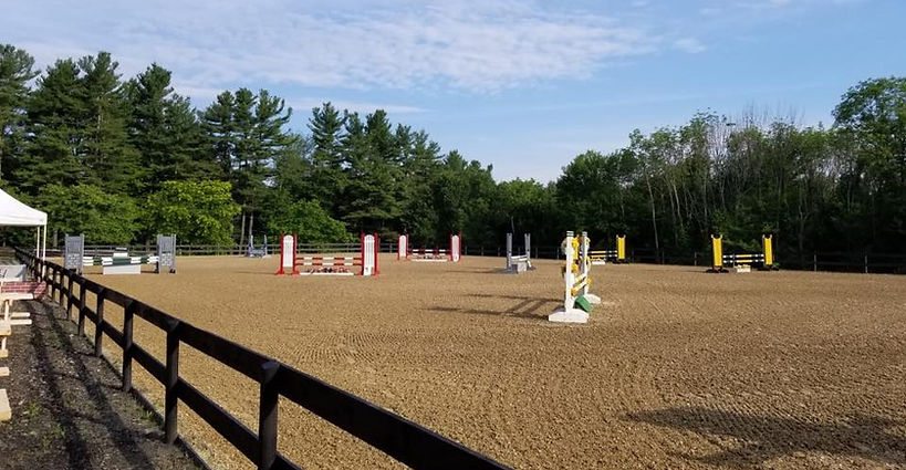 Outdoor arena full of jumps