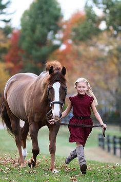 young rider running with pony
