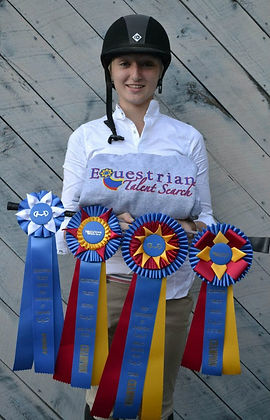 rider with champion ribbons at equestrian talent search