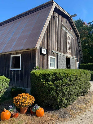 front of barn with fall decorations
