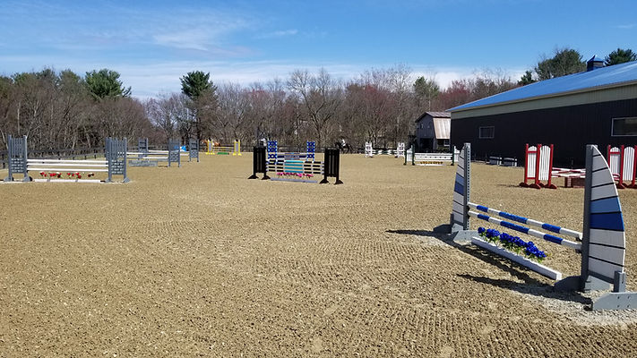 Outdoor arena with jumps