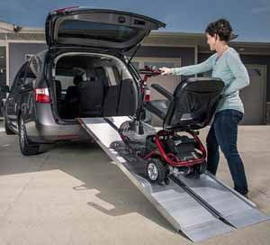 Mobility scooter on foldable transportable ramp into car