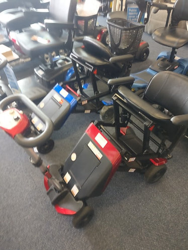 Red Monarch Smarti compact travel folding boot mobility scooter 4 MPH
