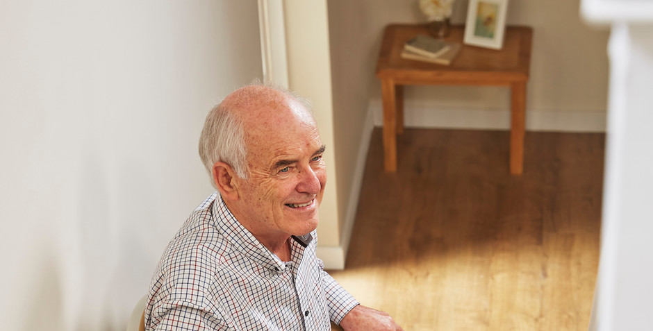 Man using stairlift