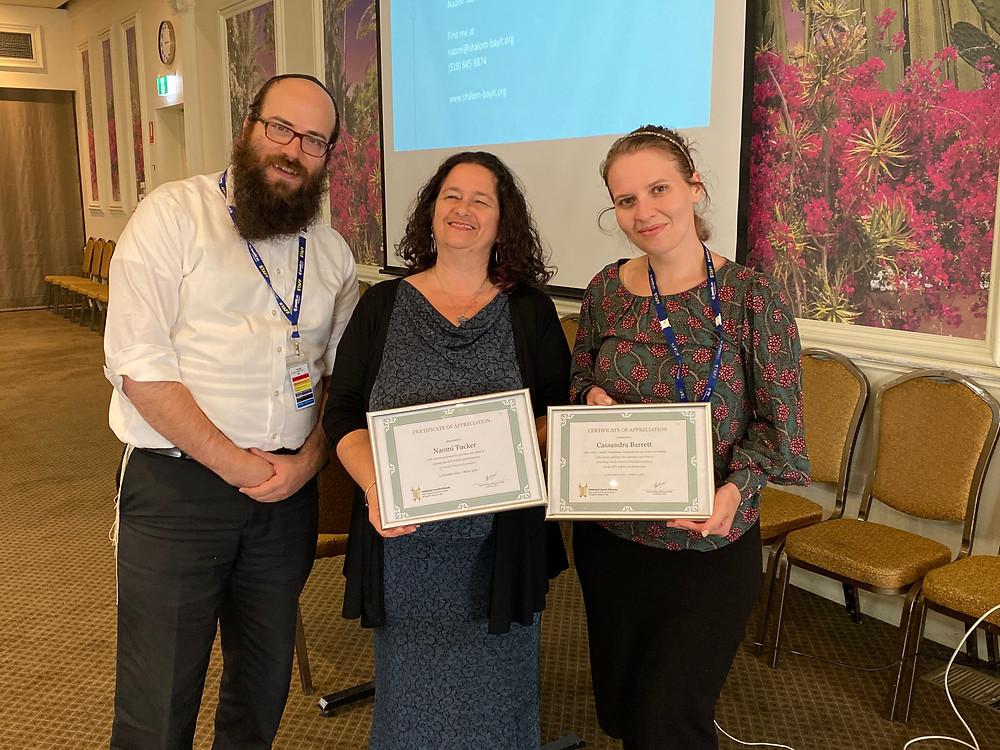 Rabbi Yoseph Nerenberg, RCV Secretary presenting Naomi Tucker and Cassie Barrett from Jewish Care Victoria with certificates of appreciation.