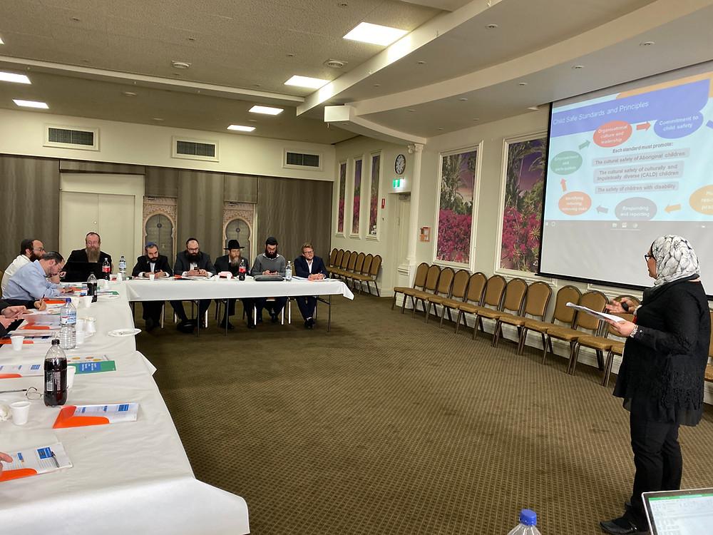 Naureen Choudhry presenting to the members
