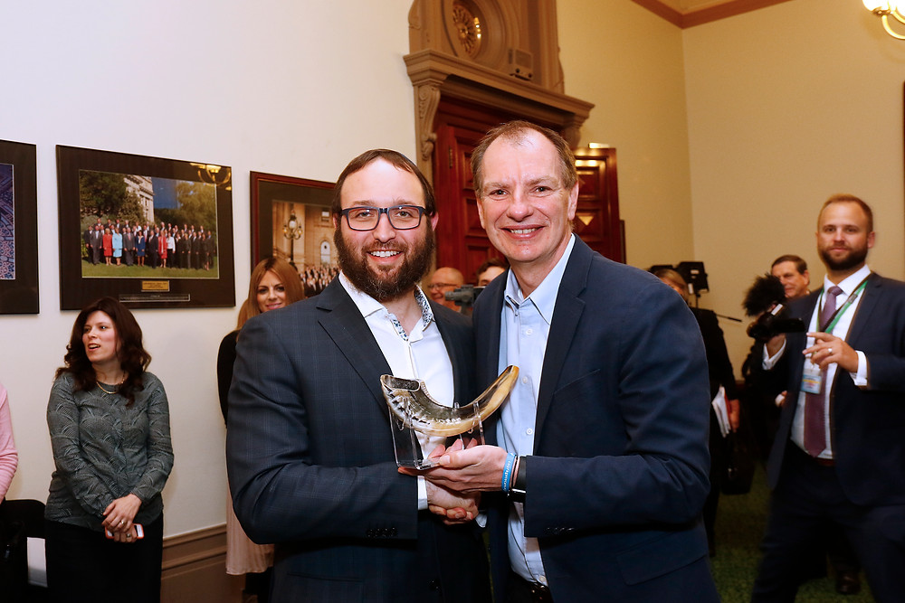 Rabbi Daniel Rabin presenting a Shofar to Mr David Southwick MP