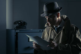 Vintage undercover agent stealing files