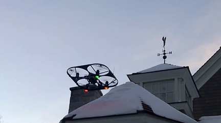 FreeBird One Scrapes Snow From Roof With Front Attachment