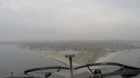 5-Mile Autonomous Flight Through Passing Shower and Winds