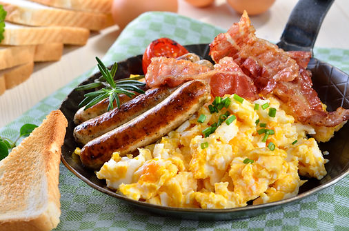 Scrambled eggs with fried bacon, fried s