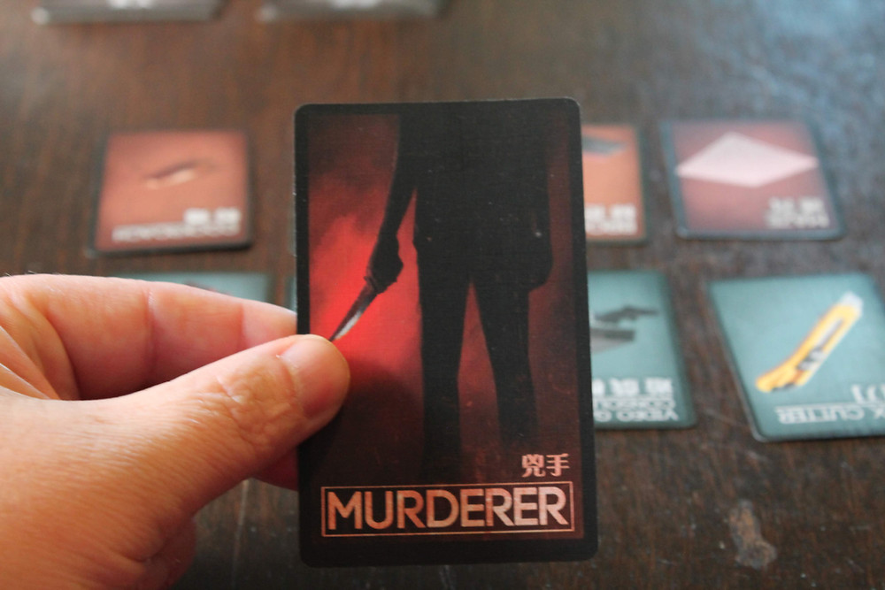 The Murderer from Deception: Murder in Hong Kong | Board Game Review | Geeky Goodies