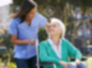 care assistant with lady in wheelchair