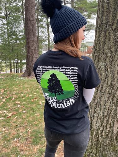 Director of Marketing for Tree-Plenish, Caroline Sprenkle, shows off her Tree-Plenish t-shirt.
