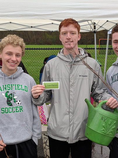 Mansfield High School students (from left to right), Peter Oldow, Will Giffen, and Cam Eddy, are ready to start planting some trees in Mansfield.