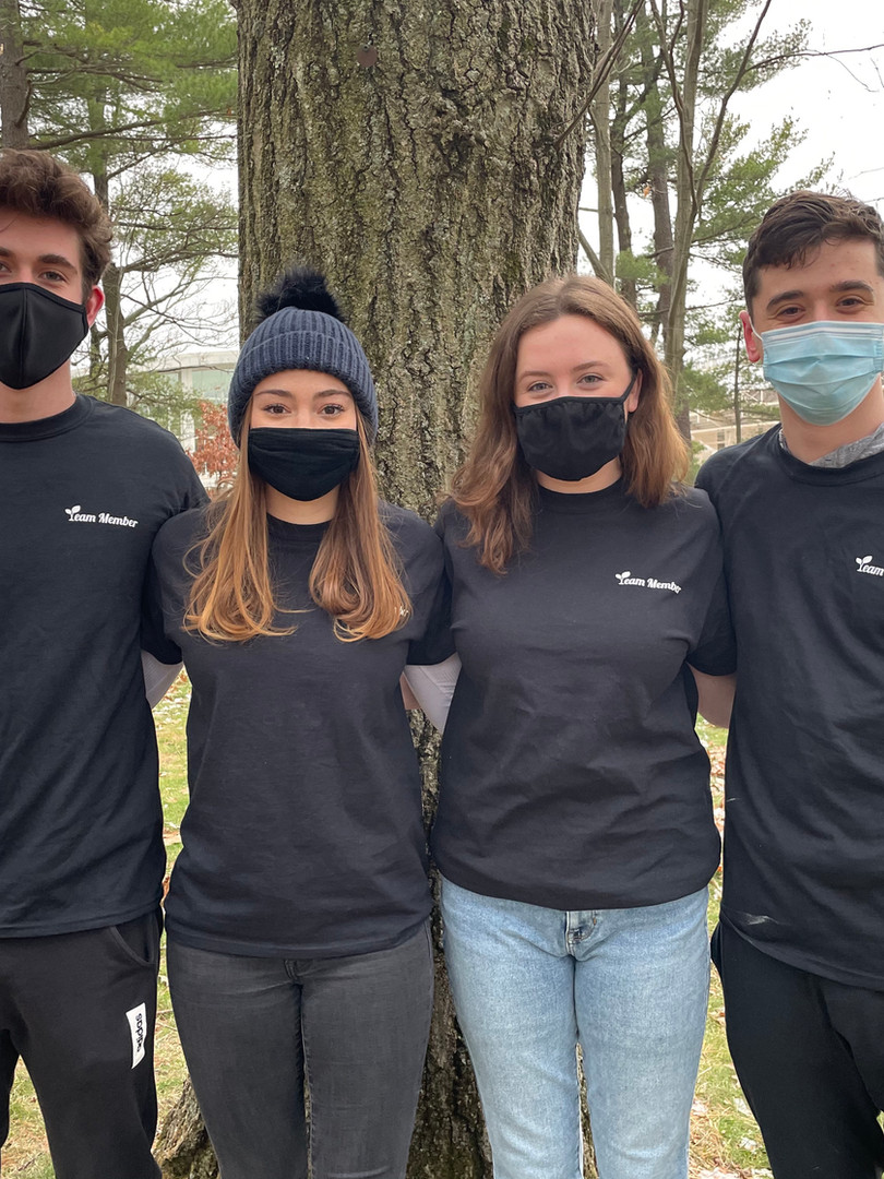 Students from Boston College and members of the Tree-Plenish team (from left to right), Alex MacDonald, Caroline Sprenkle, Michelle Goddard, and Matthew Katz, show off their Tree-Plenish t-shirts.