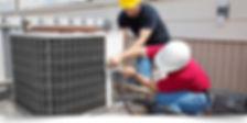 air condtioner repairmen at work