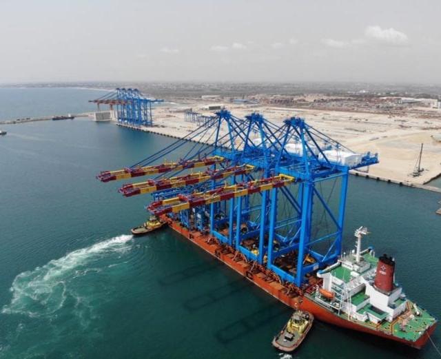 Economics-Port-Cranes-696x521.jpg
