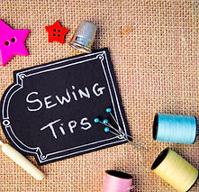 Sewing Tips on blackboard with buttons,