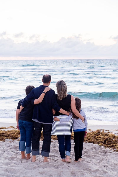 A family with their arms linked