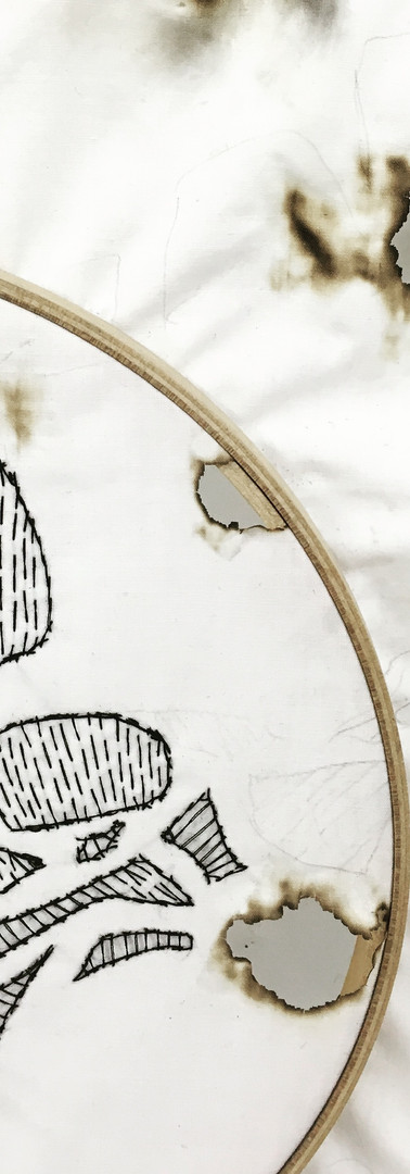 needlework on burned surface