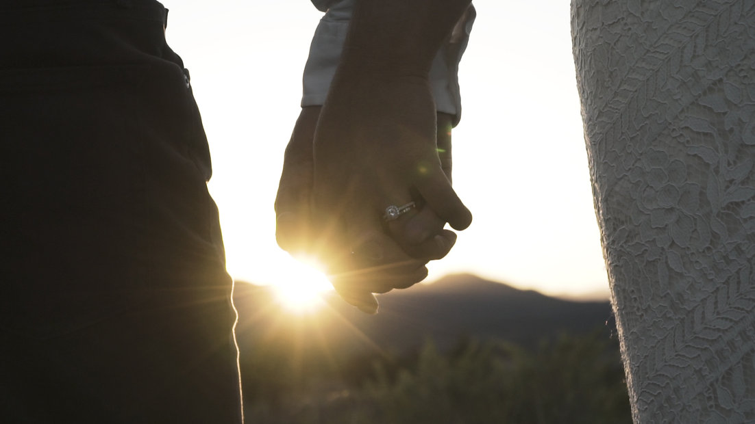 Arizona outdoor desination wedding couple holding hands