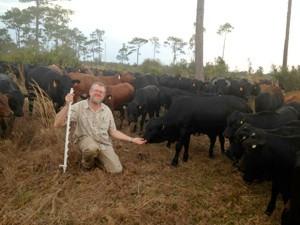 Jim Elizondo with calves.jpg