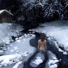 beautiful-woman-standing-in-icy-stream-w