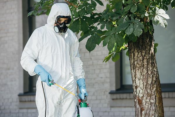 pest-control-worker-spraying-pesticides-
