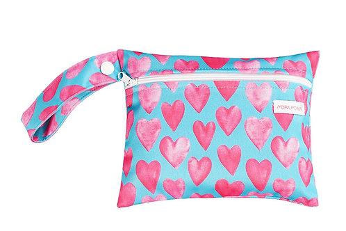 Flaww mini wet bag pink hearts blue background